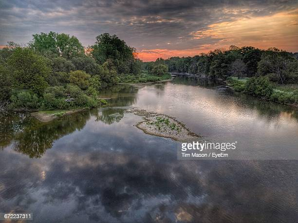 scenic view of lake against cloudy sky - london ontario stock photos and pictures