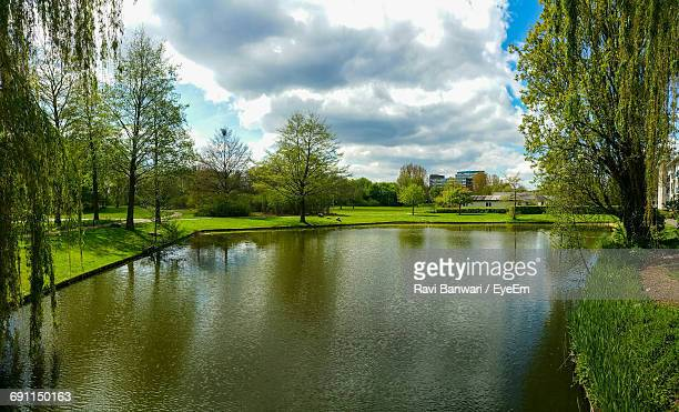 scenic view of lake against cloudy sky - dordrecht stock pictures, royalty-free photos & images