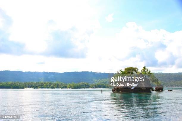 scenic view of lake against cloudy sky - davao city stock-fotos und bilder