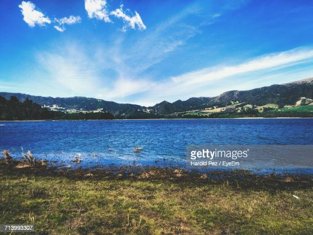 Scenic View Of Lake Against Cloudy Sky