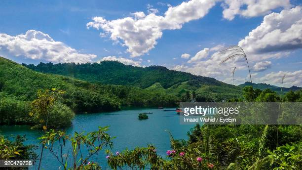 scenic view of lake against cloudy sky - sarawak state stock pictures, royalty-free photos & images