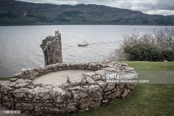 scenic view of lake against mountain - drumnadrochit stock pictures, royalty-free photos & images