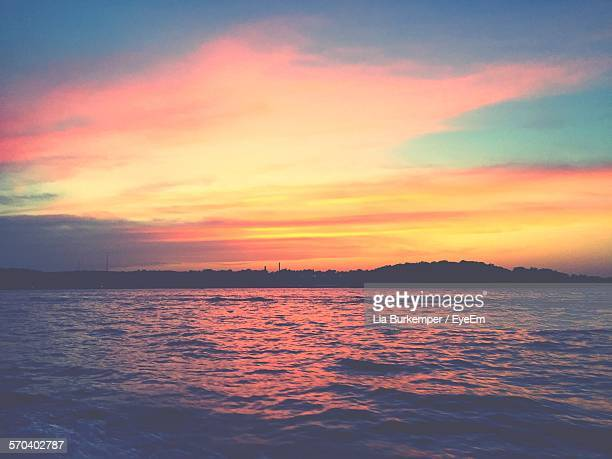 Scenic View Of Lake Against Orange Cloudy Sky