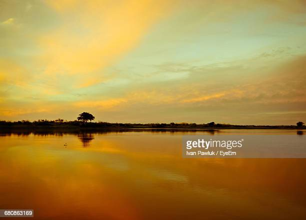 scenic view of lake against orange sky during sunset - santa fe province stock photos and pictures