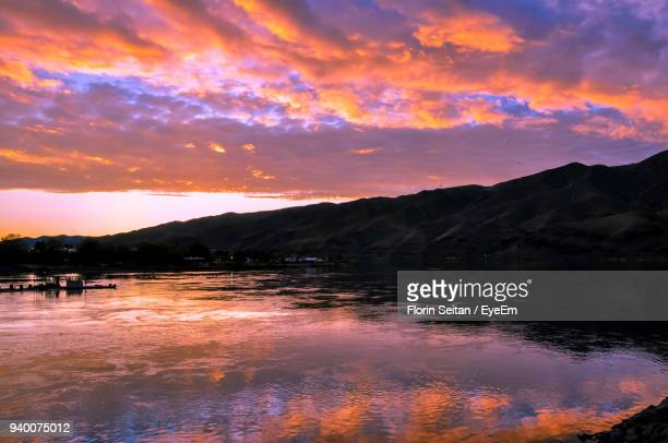 scenic view of lake against orange sky - florin seitan stock pictures, royalty-free photos & images