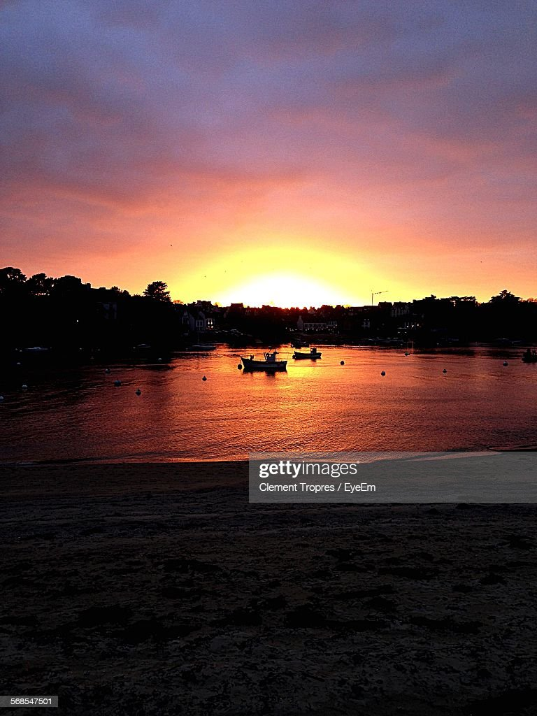 Scenic View Of Lake Against Romantic Sky At Sunset : Stock Photo
