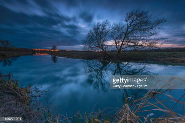 scenic view of lake against sky at dusk - northamptonshire stock pictures, royalty-free photos & images