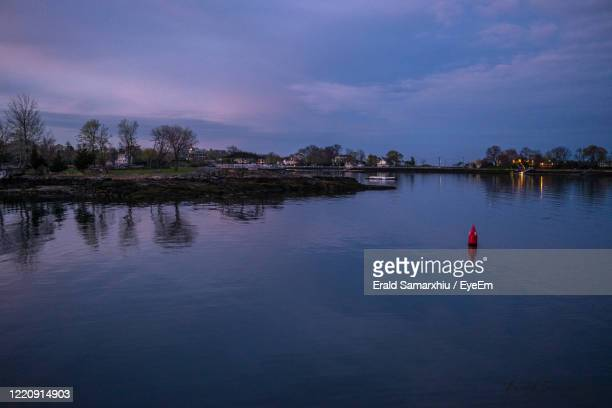 scenic view of lake against sky at dusk - westchester county stock pictures, royalty-free photos & images