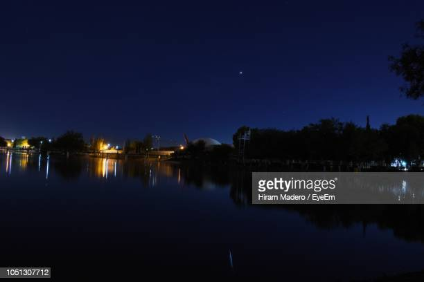 scenic view of lake against sky at night - ciudad juarez stock photos and pictures