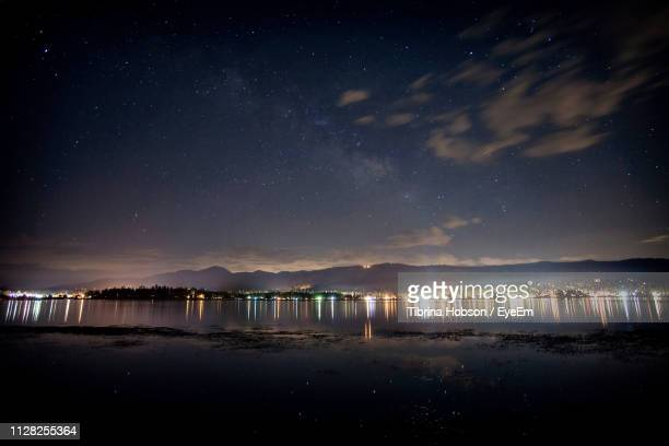 scenic view of lake against sky at night - san bernardino california stock pictures, royalty-free photos & images
