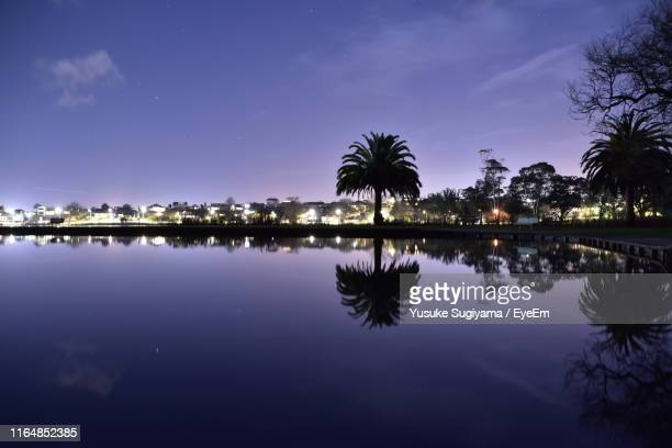 scenic view of lake against sky at night - hamilton new zealand stock pictures, royalty-free photos & images