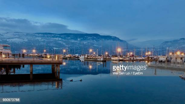 scenic view of lake against sky at night - kelowna stock pictures, royalty-free photos & images