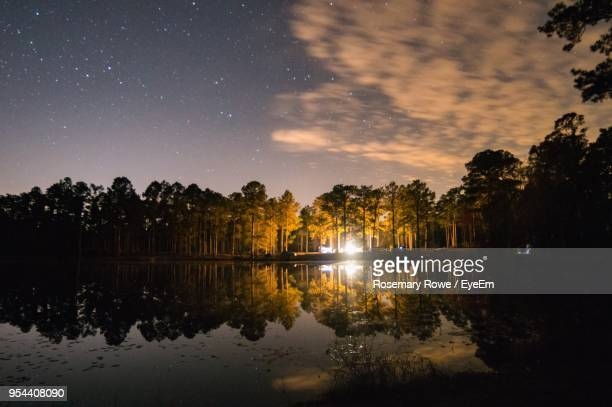 scenic view of lake against sky at night - mississippi stock pictures, royalty-free photos & images