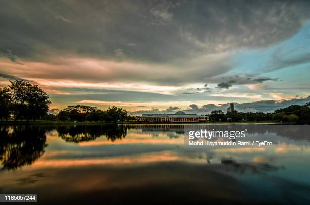 scenic view of lake against sky at sunset - sarawak state stock pictures, royalty-free photos & images