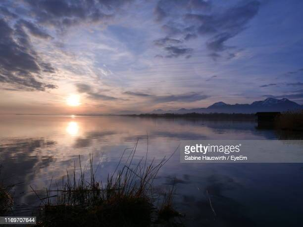 scenic view of lake against sky at sunset - sabine hauswirth stock pictures, royalty-free photos & images