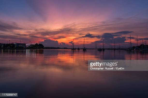 scenic view of lake against sky at sunset - annapolis stock pictures, royalty-free photos & images