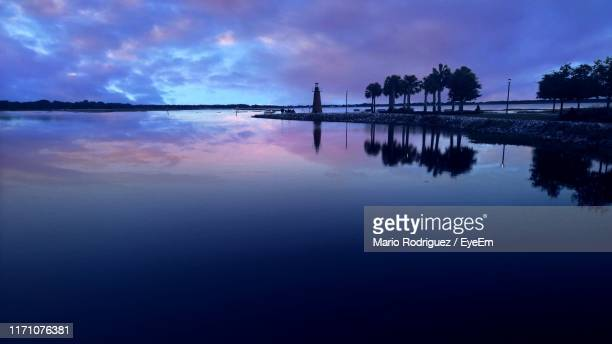 scenic view of lake against sky at sunset - kissimmee stock pictures, royalty-free photos & images