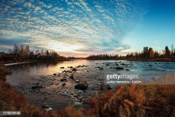 scenic view of lake against sky at sunset - heinovirta stock pictures, royalty-free photos & images
