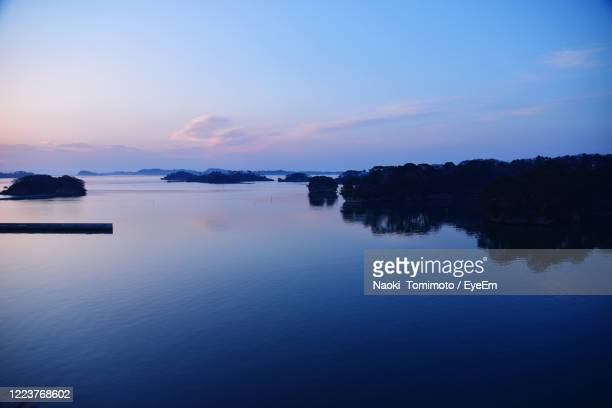 scenic view of lake against sky at sunset - 東北地方 ストックフォトと画像