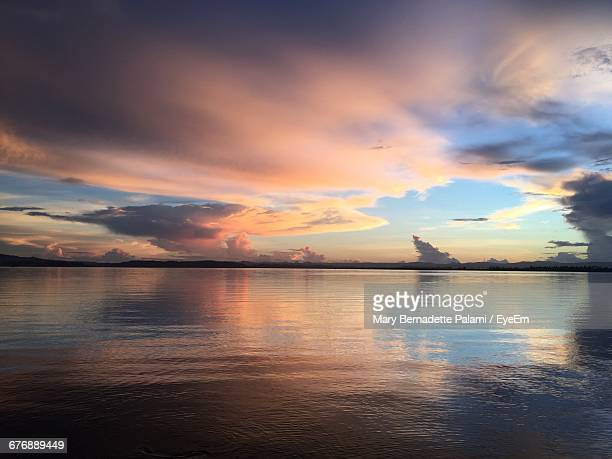 scenic view of lake against sky at sunset - mary lake stock photos and pictures