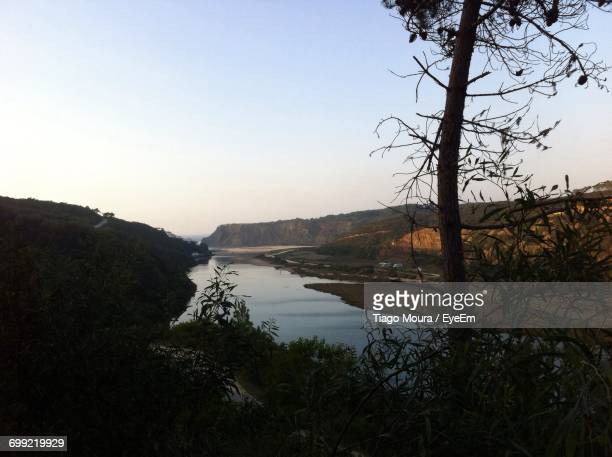 scenic view of lake against sky at sunset - moura stock photos and pictures