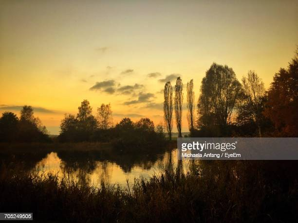 scenic view of lake against sky at sunset - anfang stock pictures, royalty-free photos & images