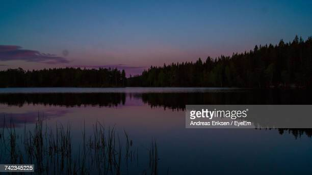 scenic view of lake against sky at sunset - eriksen foto e immagini stock