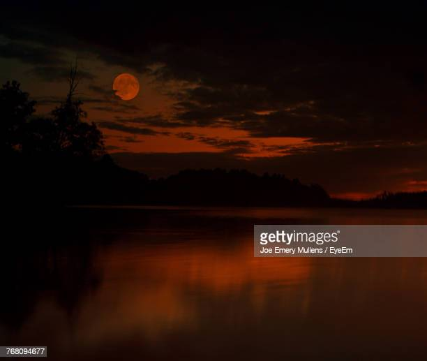 scenic view of lake against sky at sunset - emery stock photos and pictures
