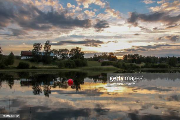 scenic view of lake against sky at sunset - dalsland stock photos and pictures