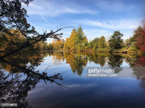 scenic view of lake against sky during autumn - colman stock photos and pictures