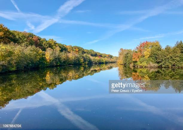 scenic view of lake against sky during autumn - ann arbor stock pictures, royalty-free photos & images