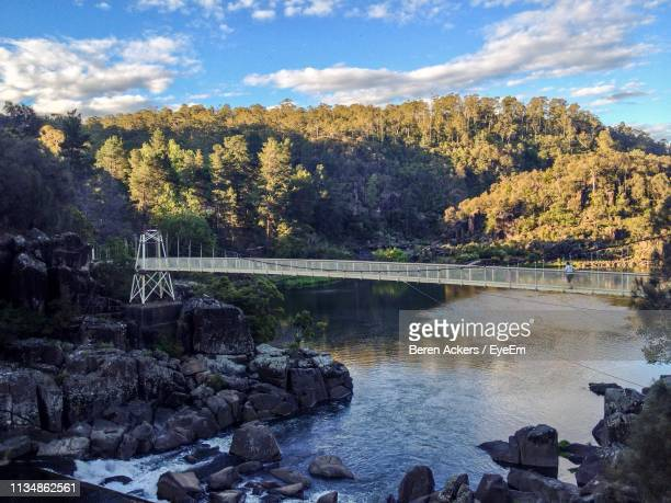 scenic view of lake against sky during autumn - launceston australia stock pictures, royalty-free photos & images