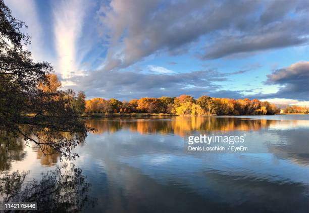 scenic view of lake against sky during autumn - wolfsburg lower saxony stock pictures, royalty-free photos & images