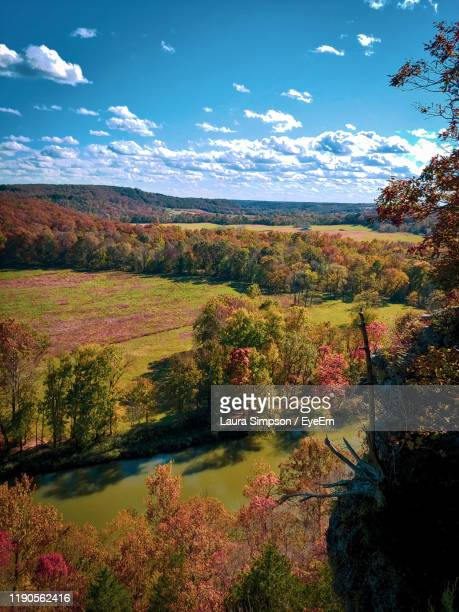 scenic view of lake against sky during autumn - ozark mountains stock pictures, royalty-free photos & images