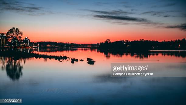 scenic view of lake against sky during sunset - espoo stock pictures, royalty-free photos & images