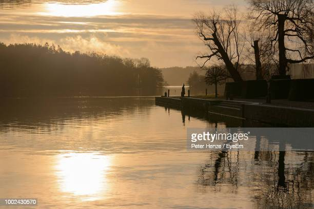 scenic view of lake against sky during sunset - drottningholm palace stock pictures, royalty-free photos & images