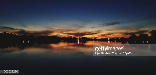 scenic view of lake against sky during sunset - hamilton new zealand stock photos and pictures