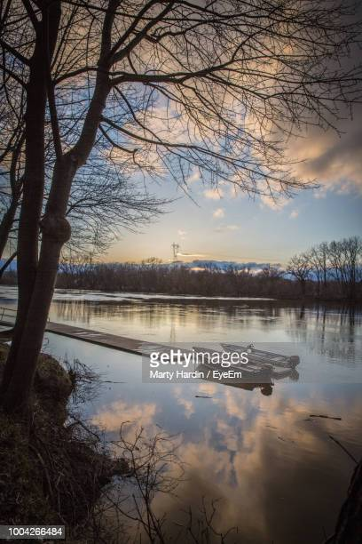 scenic view of lake against sky during sunset - marty hardin stock photos and pictures