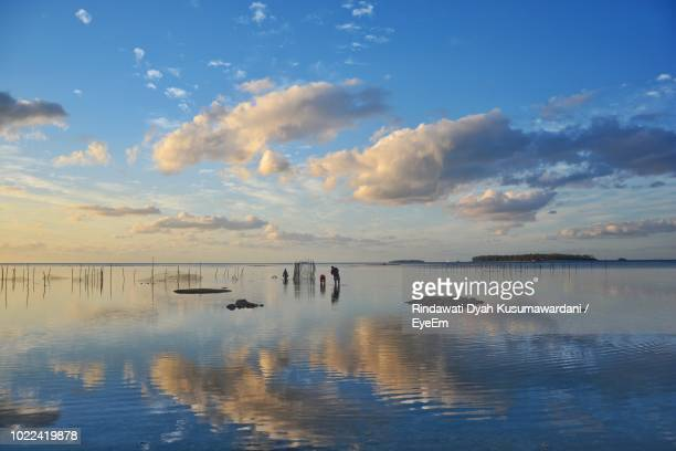 scenic view of lake against sky during sunset - nuku'alofa stock pictures, royalty-free photos & images