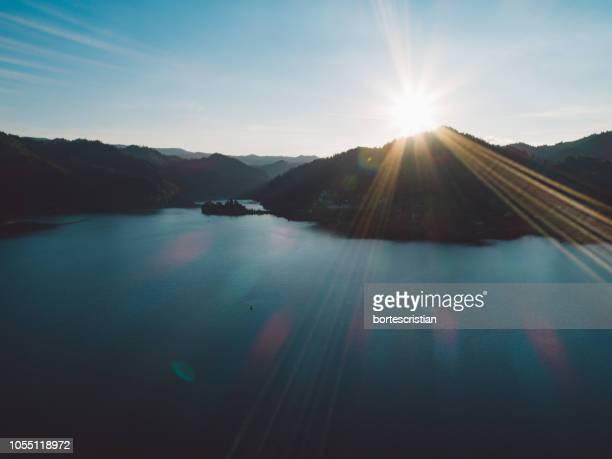 scenic view of lake against sky during sunset - bortes stock-fotos und bilder