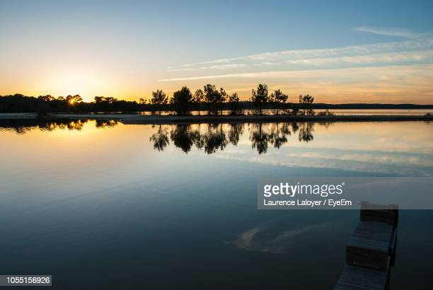 scenic view of lake against sky during sunset - biscarrosse photos et images de collection