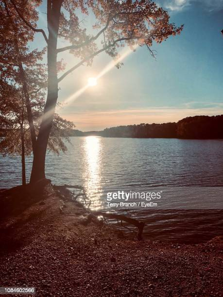 scenic view of lake against sky during sunset - henderson nevada stock pictures, royalty-free photos & images