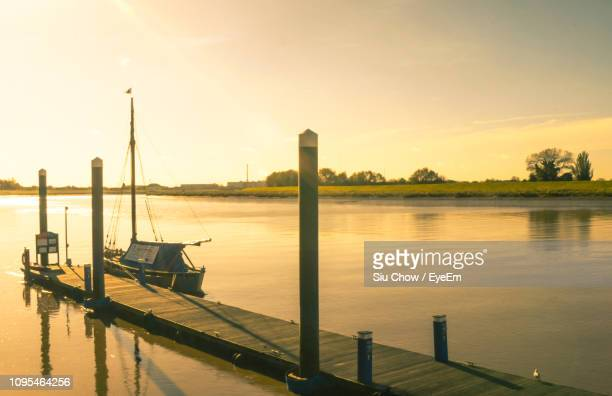 scenic view of lake against sky during sunset - king's lynn stock pictures, royalty-free photos & images