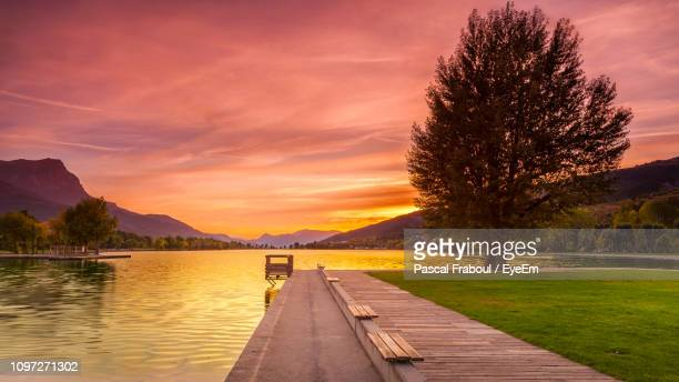 scenic view of lake against sky during sunset - embrun stock pictures, royalty-free photos & images