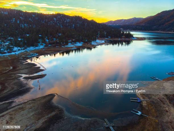 scenic view of lake against sky during sunset - big bear lake stock photos and pictures