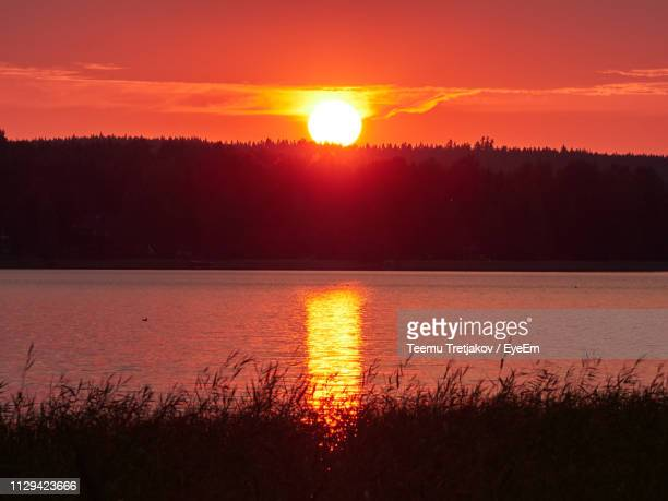 scenic view of lake against sky during sunset - teemu tretjakov stock pictures, royalty-free photos & images