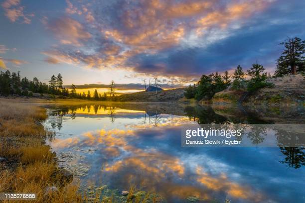 scenic view of lake against sky during sunset - kamloops stock pictures, royalty-free photos & images