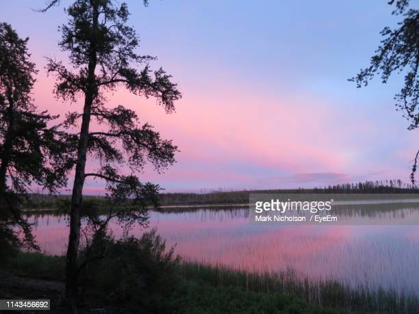 scenic view of lake against sky during sunset - mark's stock pictures, royalty-free photos & images