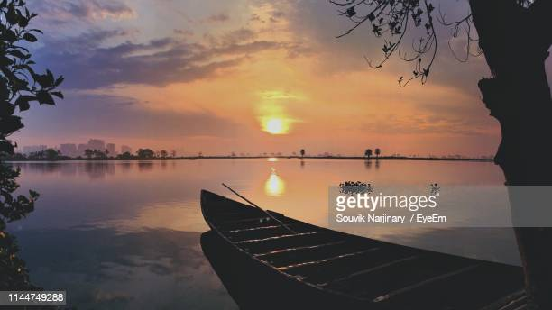 scenic view of lake against sky during sunset - kolkata stock pictures, royalty-free photos & images