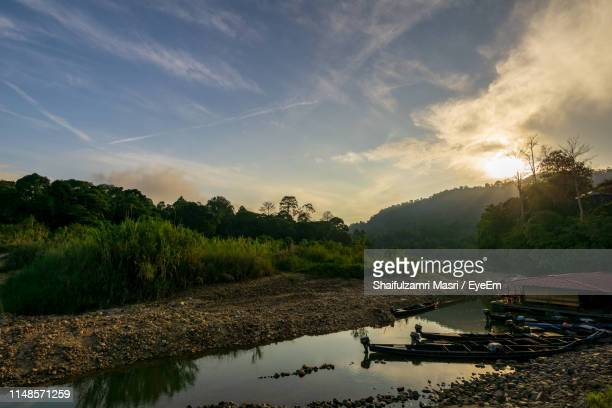 scenic view of lake against sky during sunset - taman negara national park stock photos and pictures